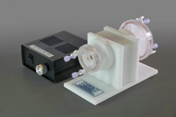 Pictured with power supply, rotator base , 10mL and 50mL disposable HARVs